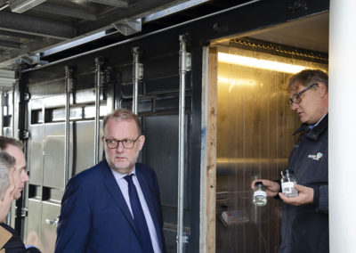 At the CBS1 facility, product delivery part. From left: Thomas Helmer Pedersen; Jacob Stoustrup, Lars Christian Lilleholt, Steen B. Iversen (showing sustainable fuels produced from biomass). Credits: AAU